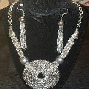 Oversized metal necklace and earrings